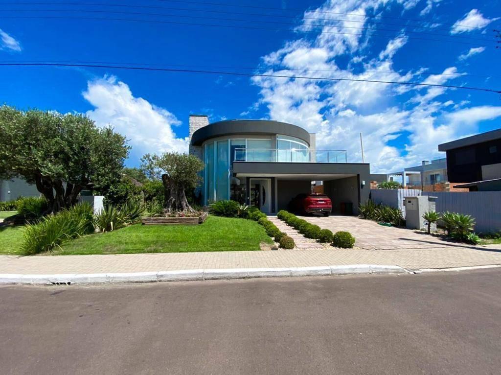 Casa em Condomínio 4 dormitórios em Capão da Canoa | Ref.: 2528